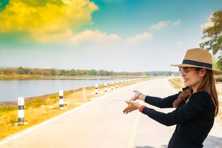 Asian Woman with Mae Moh Reservoir Background, Lampang Province.