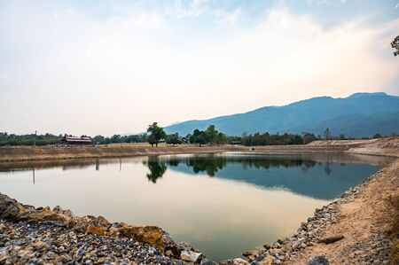 Reservoir with mountain view in Chiang Mai province, Thailand. 免版税图像