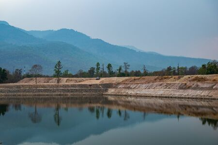 Reservoir with mountain view in Chiang Mai province, Thailand. Banco de Imagens