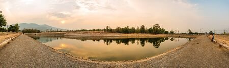 Panorama view of reservoir with tree reflection in Chiang Mai province, Thailand. 免版税图像