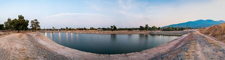 Panorama view of reservoir with mountain view at sunset, Chiang Mai province.