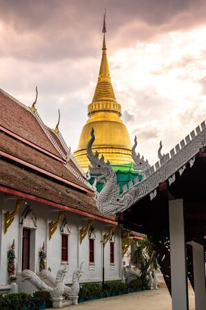 Ancient pagoda with church in Phra Kaew Don Tao temple, Lampang province.