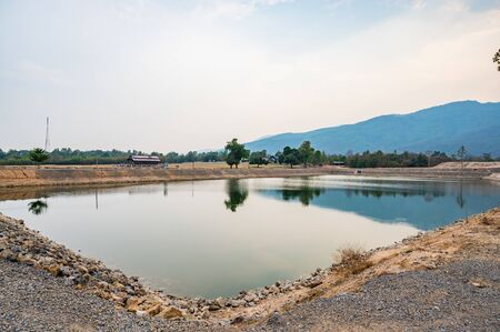 Reservoir with mountain view in Chiang Mai province, Thailand.