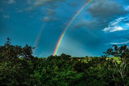 Rainbow with tree foreground at Chiangmai province, Thailand. Stockfoto
