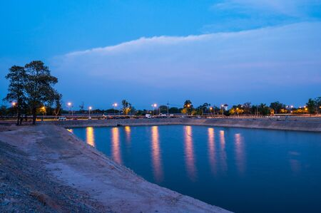 Reservoir with walkway at sunset, Chiang Mai province.