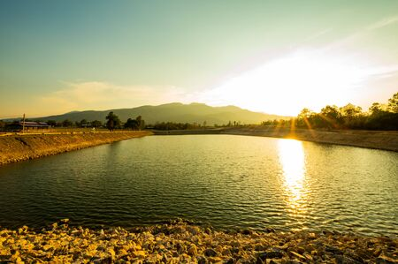 Reservoir with mountain view at sunset, Chiang Mai province.