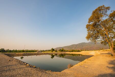Reservoir with mountain view at evening, Chiang Mai province. Banco de Imagens