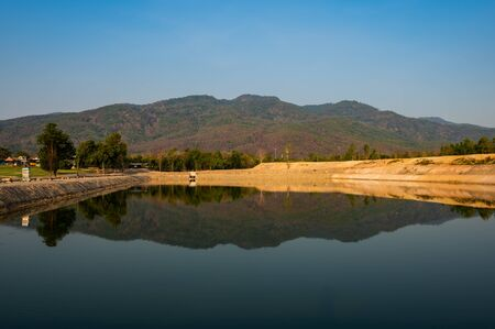 Reservoir with mountain view at evening, Chiang Mai province.