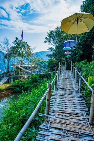 Bamboo bridge with mountain view in Pha Hi village, Chiang Rai province.