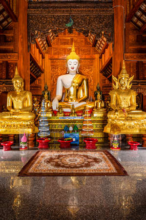 CHIANG MAI, THAILAND - April 24, 2020 : White Buddha statue in Ban Den temple, Chiang Mai province.