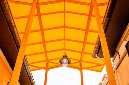 Orange translucent roof or orange skylight roof with lamp, Thailand. Reklamní fotografie