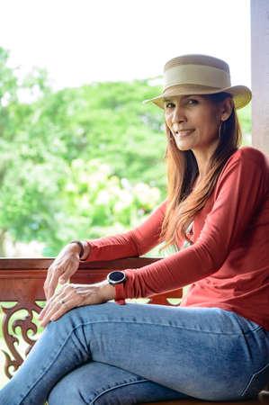 Asian woman at Thai style balcony, Phayao province.