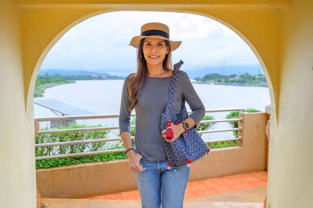 Asia Woman Traveler with Golden Triangle Background, Chiang Rai Province.