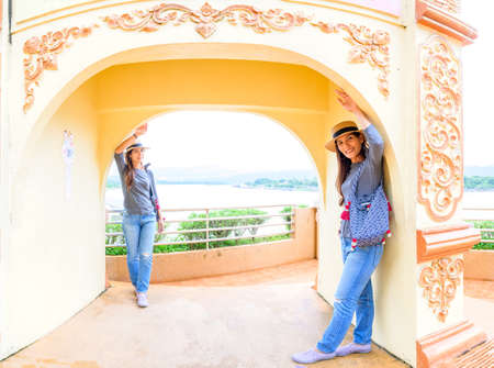 Twin Women Traveler with Golden Triangle Background, Chiang Rai Province.
