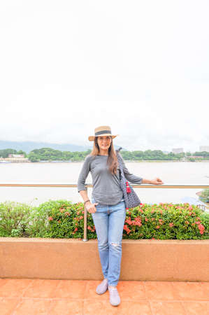 A Woman Traveler with Golden Triangle Background, Chiang Rai Province.