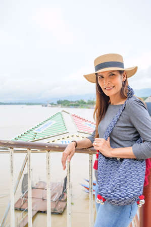 A Woman Traveler with Mekong River View at Golden Triangle, Chiang Rai Province.
