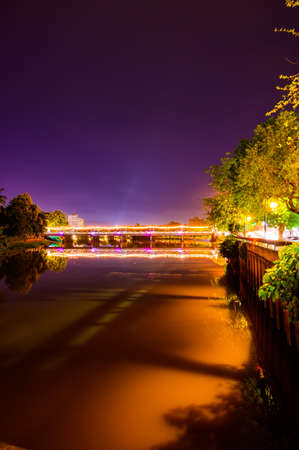 Nawarat Bridge with Ping River at Night in Chiang Mai Province, Thailand.