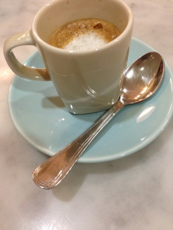 cortado: Cup of coffee express over a blue dish Stock Photo