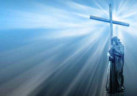 jesus holding a cross on blue background with white rays photo
