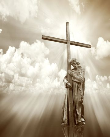 jesus holding a cross on cloud sepia background  photo