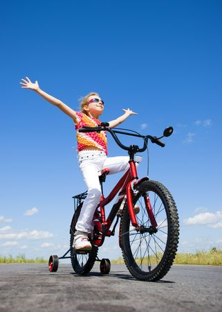 girl on bicycle at sunny day