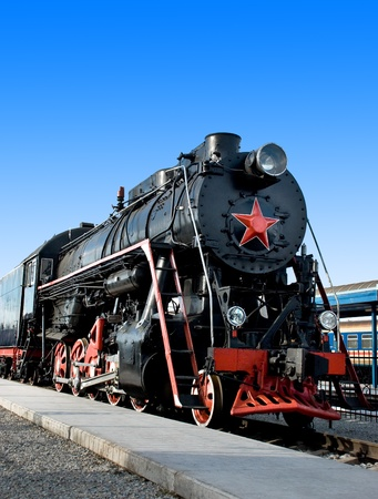 old black locomotive with red star  photo