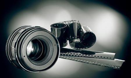 photographic: lens & film strip on dark background