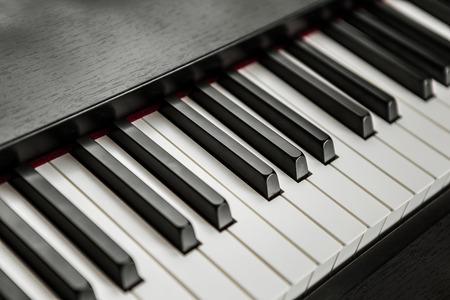 piano closeup: fragment of piano keyboard Stock Photo