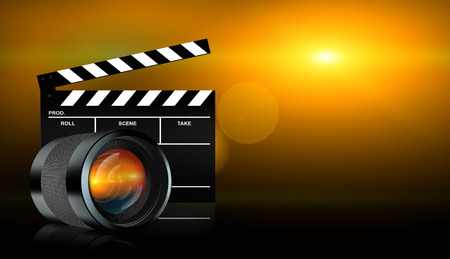 clap board: photographic lens and clap board on dark background Stock Photo