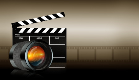 photographic lens and clap board on dark background Stock Photo