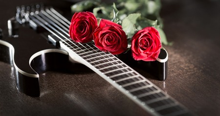 three roses on black electric guitar