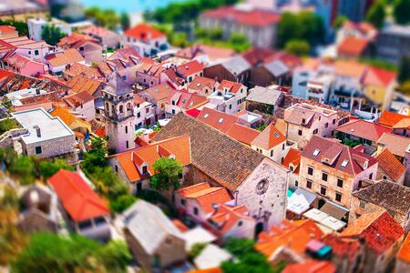 red tile roofs of the houses in the old tomn Omis in Croatia Standard-Bild
