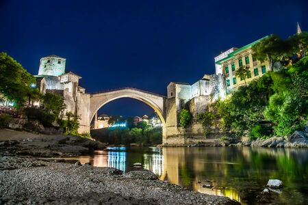 night view of river Neretva and old bridge in Mostar in Bosnia and Gerzegovina