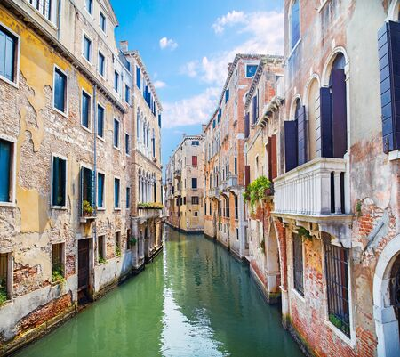 water channel between old buildings in Venice in Italy Standard-Bild