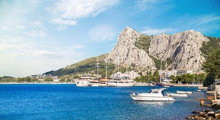ships on the pier near the mountains in Omis in Croatia Standard-Bild