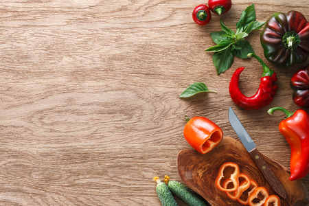 cocina saludable: A set of different peppers and other vegetables on textured wooden background. Top view.