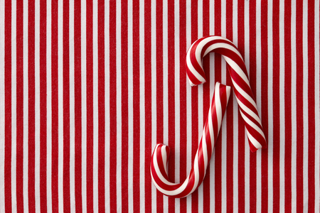 peppermint candy: Striped peppermint candy canes on a striped textile background Stock Photo