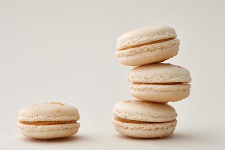beige: Beige french macarons on a beige background