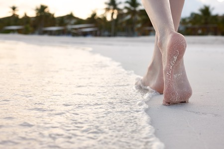 barefoot people: Woman walking on white sand beach, tropical landscape