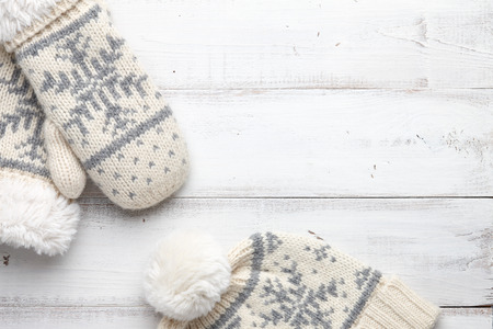 mittens: Winter background with knitted mittens and cap
