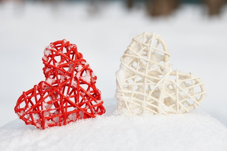 Red and white hearts on snow winter background. Love and Valentines Days concept