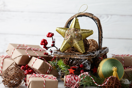 Christmas decorations basket on white planks