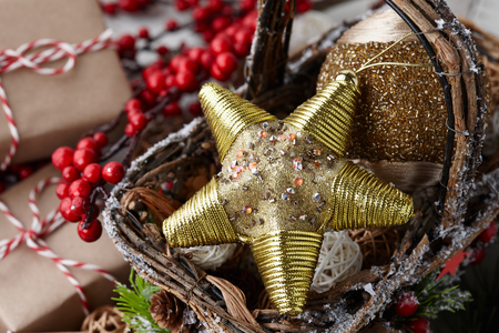 Christmas golden star and holiday decorations