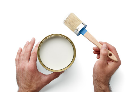 Mans hands holding paint brush and can isolated on white background, top view Stock Photo