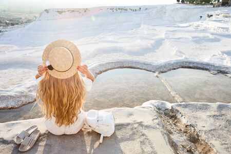 Young woman enjoying the views of Pamukkale travertine in Turkey