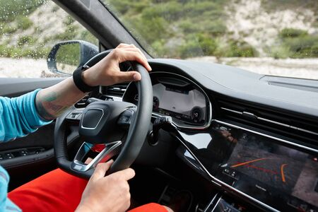 Man driving car cross country in Alps, summer traveling Archivio Fotografico