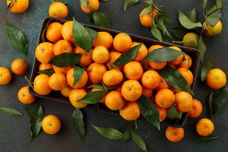 Fresh mandarin oranges with leaves. Seasonal winter fruits for Christmas.