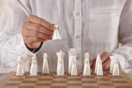 Man playing chess, hand close up view. Victory game. Standard-Bild