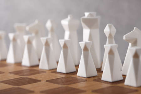 Chess board with white pieces. Intellectual competition. Standard-Bild