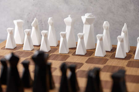 Chess board with white and black pieces. Intellectual competition. Standard-Bild
